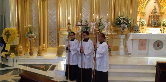 The crucifer and candle bearers.