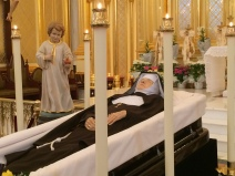The Child Jesus watches over Mother Angelica, in the shrine she built for Him.